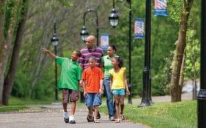 Family walking along Riverwalk Trail in Pigeon Forge, TN
