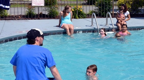 family in pigeon forge at ramada pool