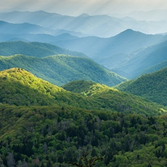 smoky mountains day light shining on green hills