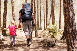 dad-and-daughter-hiking-in-mountains-300×200