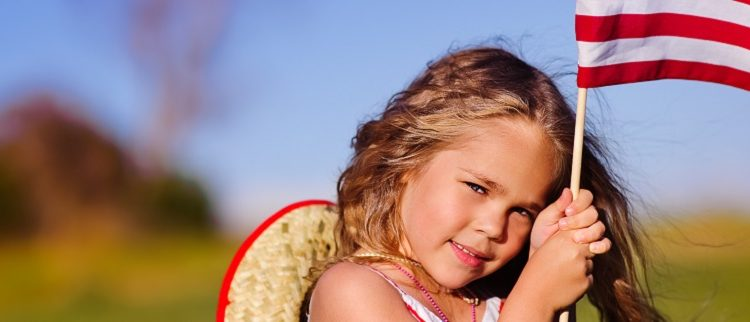 young-girl-holding-flag-1271×322