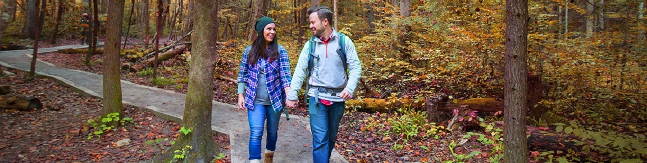 Couple Hiking During Fall in Great Smoky Mountains National Park